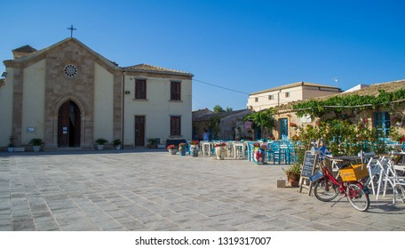 Marzamemi, Siracusa, Italy - 06/29/2018: The spectacular and colorful square of Marzamemi