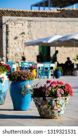 Marzamemi, Siracusa, Italy - 06/29/2018: The spectacular and colorful ceramic vases in the square of Marzamemi
