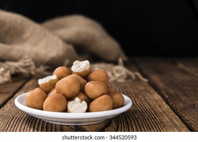 Marzipan Potatoes (German cuisine) on rustic wooden background