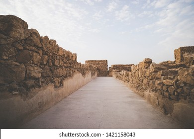 Masada fortress, ancient fortification in Israel situated on top of an isolated rock plateau. One of the passages inside Masada fortification, Israel. Old ruined stone walls. Architecture of the past