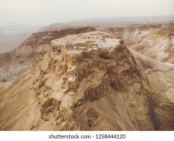 Masada fortress area Southern District of Israel Dead Sea area Southern District of Israel. Ancient Jewish fortress of the Roman Empire on top of a rock in the Judean desert. front view from the air