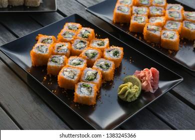 Masago caviar sushi. Sushi rolls with Philadelphia cheese and masago caviar.