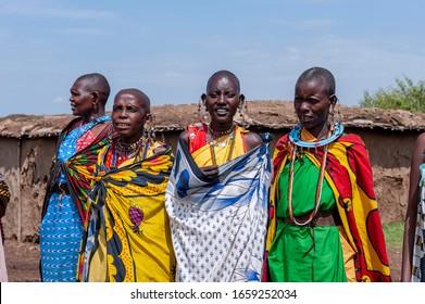 Masai Mara, Kenya; 12/10/2010. Masai women in a Masai Mara camp, wearing traditional dresses