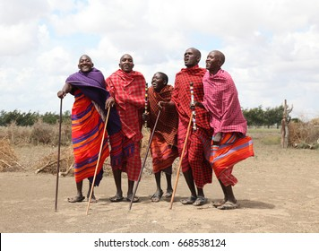 Masai Mara, Kenya,  Africa – March 6, 2010: A group of Masai men performing their ritual dance in traditional clothes in their village on March, 2010 in Kenya.