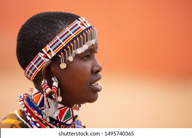 Masai Mara, Kenya - August, 2019: The Masai woman portrait near entrance of Masai Mara National Reserve.
