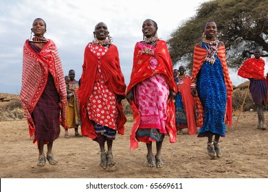 MASAI MARA, KENYA - AUGUST 23: Group of unidentified African women from Masai tribe show a traditional Jump dance on August 23, 2010 in a local village near Masai Mara National park, Kenya.