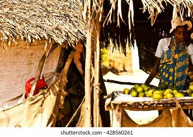 MASAI MARA, KENYA.  DECEMBER 18, 2011:  Kenyan woman selling fruit at a market in Kenya.