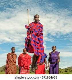 MASAI MARA, KENYA - DECEMBER 2, 2011: Unidentified Masai warriors participate in competitions in traditional high jump as part of the cultural ceremonies and dances in the Masai Mara National Park