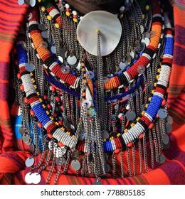 Masai Mara - Kenya / December 2017: colorful Masai accessories with beautiful details as seen in Masai man chest.