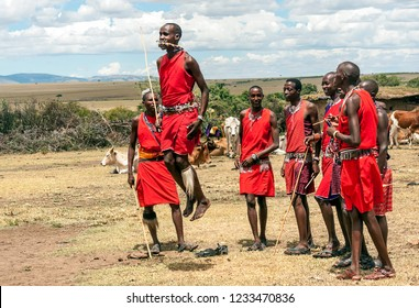 MASAI MARA, KENYA - MAY 2014. Unidentified Masai warriors participate in competitions in traditional high jump as part of the cultural ceremonies and dances in the Masai Mara National Park