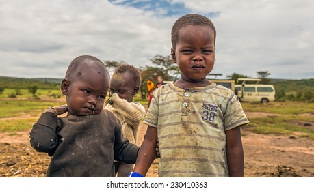 MASAI MARA, KENYA - OCTOBER 17, 2014: Two african boys from Masai tribe in their village. The Maasai are a Nilotic ethnic group living in southern Kenya and northern Tanzania