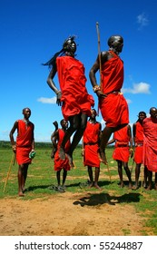 MASAI MARA,KENYA, AFRICA-NOVEMBER 12:Masai warriors dancing traditional jumps as cultural ceremony,review of daily life of local people,near to Masai Mara National Park Reserve,November 12,2008,Kenya