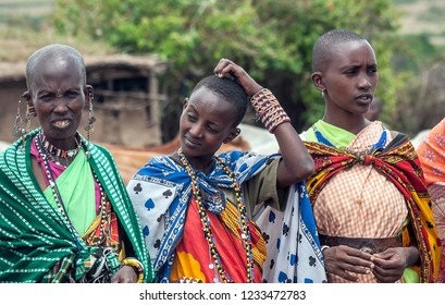 MASAI MARA,KENYA-MAY 14: Portrait on an African woman of Masai Mara tribe village looking to camera,review of daily life of local people,near Masai Mara National Park