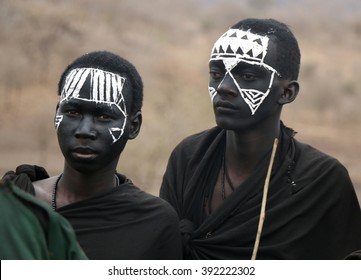 Masai Young Warriors / Portrait of unidentified Masai warriors with traditional black and white face painting after being circumcised. Photo taken on October 7th, 2015 near Karatu, Tanzania.