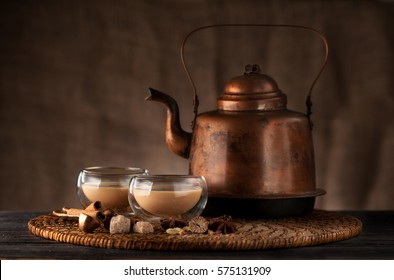 masala chai, spices and spicy on a wooden table