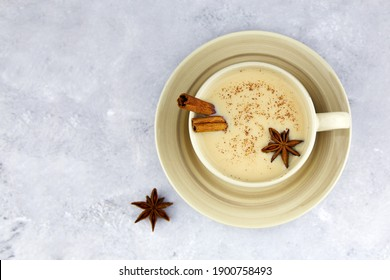 Masala chai tea. Traditional Indian hot drink-masala tea with spices on a light background.