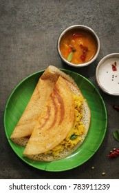 Masala Dosa / Indian lentil  Crepes with potato filling , top down view