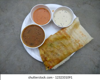 Masala dosa with sambhar and chutney, very famous south indian dish. Top view