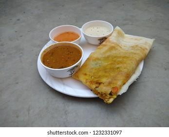 Masala dosa with sambhar and chutney, very famous south indian dish.