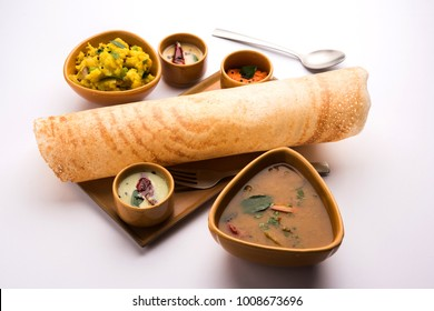 Masala dosa is a South Indian meal served with sambhar and coconut chutney. Selective focus