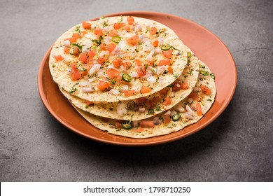 Masala Papad orpapadumis a delicious Indian snack made using roasted or fried papad topped with a tangy and spicy onion tomato mix