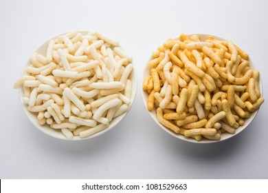 Masala and plain Puffed Rice, wheat or Corn snack, crunchy white Fryums served in a bowl. selective focus