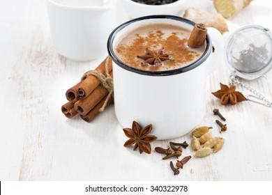 Masala tea and ingredients, closeup, horizontal