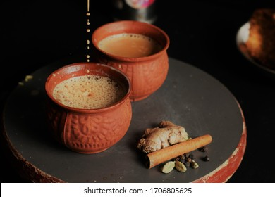 Masala Tea is Popularly known in India as Masala Chai or Herbal tea is under process of Pouring in Earthen cups known as Kulhad. (Masala Chai/Kulhad chai)