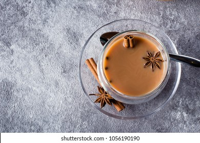 MasalaMasala tea in ceramic cup with spices on light gray stone table background. Indian tea. Copy space, top view