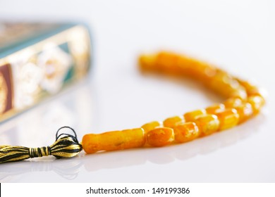 The Masbaha is also known as Tasbih is a string of prayer beads which is traditionally used by Muslims to keep track of counting in tasbih - seen here with the Quaran