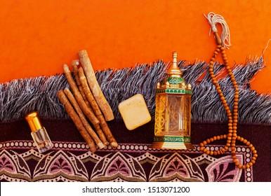 Mascara, Algeria - September 8, 2019: Ornamental Arabic lantern oud perfume with  rosary, siwak, perfum prayer mat Ramadan Kareem Greeting Card. Ramadan Mubarak. Translated: Happy & Holy Ramadan.