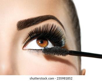 Mascara applying. Long Lashes closeup. Mascara Brush. Eyelashes extensions. Makeup for Brown Eyes. Eye Make up Apply