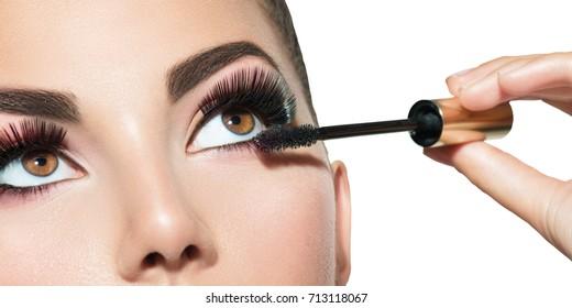 Mascara Applying. Long Lashes closeup. Mascara Brush. Eyelashes extensions. Makeup for Brown Eyes. Eye Make up Apply, Eyebrows shaping. Beautiful woman eyes make-up