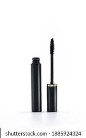 Mascara Black Bottle and Applicator Brush. Fashionable cosmetics Makeup for Eyes, Black Mascara wand and Tube Isolated on White. Extensible mascara and volume.