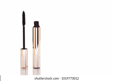 Mascara Bottle and Brush. Fashionable cosmetics Makeup for Eyes, Black Mascara wand and Tube Isolated on White. Extensible mascara and volume, Gold Bottle. Mascara on Light Background, New Form