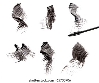 Mascara brush and strokes isolated on white