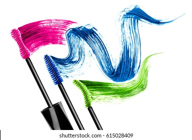 Mascara brushes with colored mascara strokes, isolated on white background