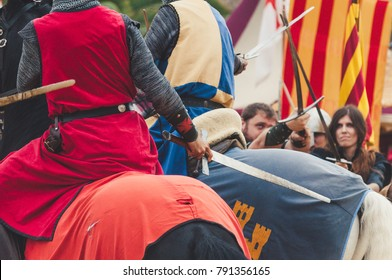 MASCARELL, SPAIN - NOVEMBER 2017 - A group of men simulate a medieval battle during the celebration of the medieval fair.