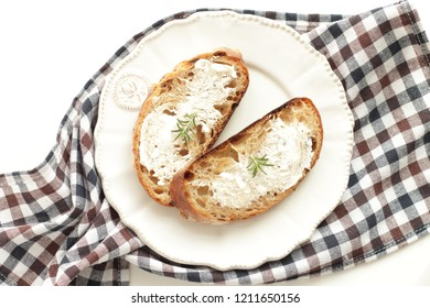 Mascarpone and rosemary on French french for breakfast image