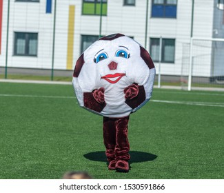 The mascot of the football team. in the form of a ball