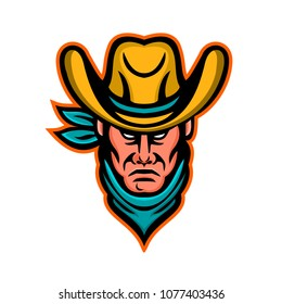 Mascot icon illustration of head of an American cowboy wearing hat viewed from front on isolated background in retro style.