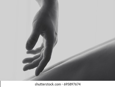 Masculine hand caressing a female back