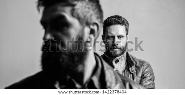 Masculinity and brutal appearance. Male hair care tips. Barbershop concept. Men handsome with beard and mustache facial hair. Barber and beard grooming. Masculine men with well groomed beard.