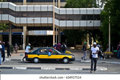 Maseru, Lesotho – January 26, 2017: Basotho people go about their busy city lives in Maseru, the capital of Lesotho. Lesotho is known as the Kingdom in the Sky because of its lofty altitude.