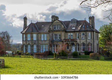 MASHAM, YORKSHIRE, UK - APRIL 28, 2018: A beautiful Victorian mansion located in the Yorkshire village of Masham, was previously the home of the Theakston family of brewers who still brew nearby.