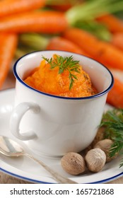 mashed carrots in the bowl with the nutmeg