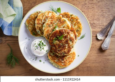 Mashed potato and cheese cakes, served with sour cream or yogurt. Potato Pancakes, Fritters. overhead, horizontal