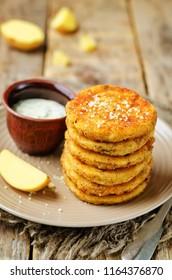 Mashed Potato Cheese Pancakes with Greek Yogurt Dill Sauce. toning. selective focus