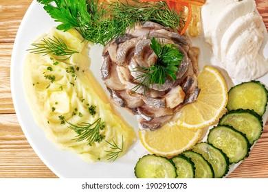 Mashed potato herring and lemon, close-up, top view