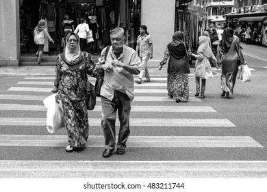 MASJID INDIA, MALAYSIA 20 OKTOBER 2015 : People walk Tunku Abdul Rahman Road (Jalan TAR) , one of the most popular street bazaar in the heart of Kuala Lumpur.